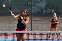 Plainview's Desiree Gutierrez powers the ball down as partner Miranda McIllroy looks on during a second flight doubles match against Hereford on Tuesday at the Plainview High School tennis courts.