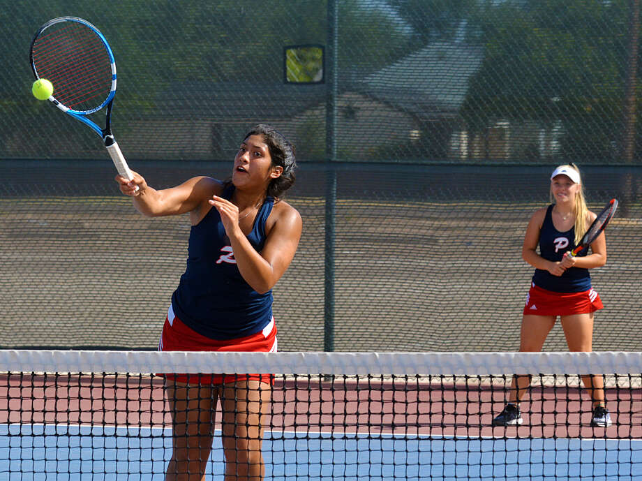 Plainview's Desiree Gutierrez powers the ball down as partner Miranda McIllroy looks on during  a second flight doubles match against Hereford on Tuesday at the Plainview High School tennis courts. Photo: Nathan Giese/Planview Herald