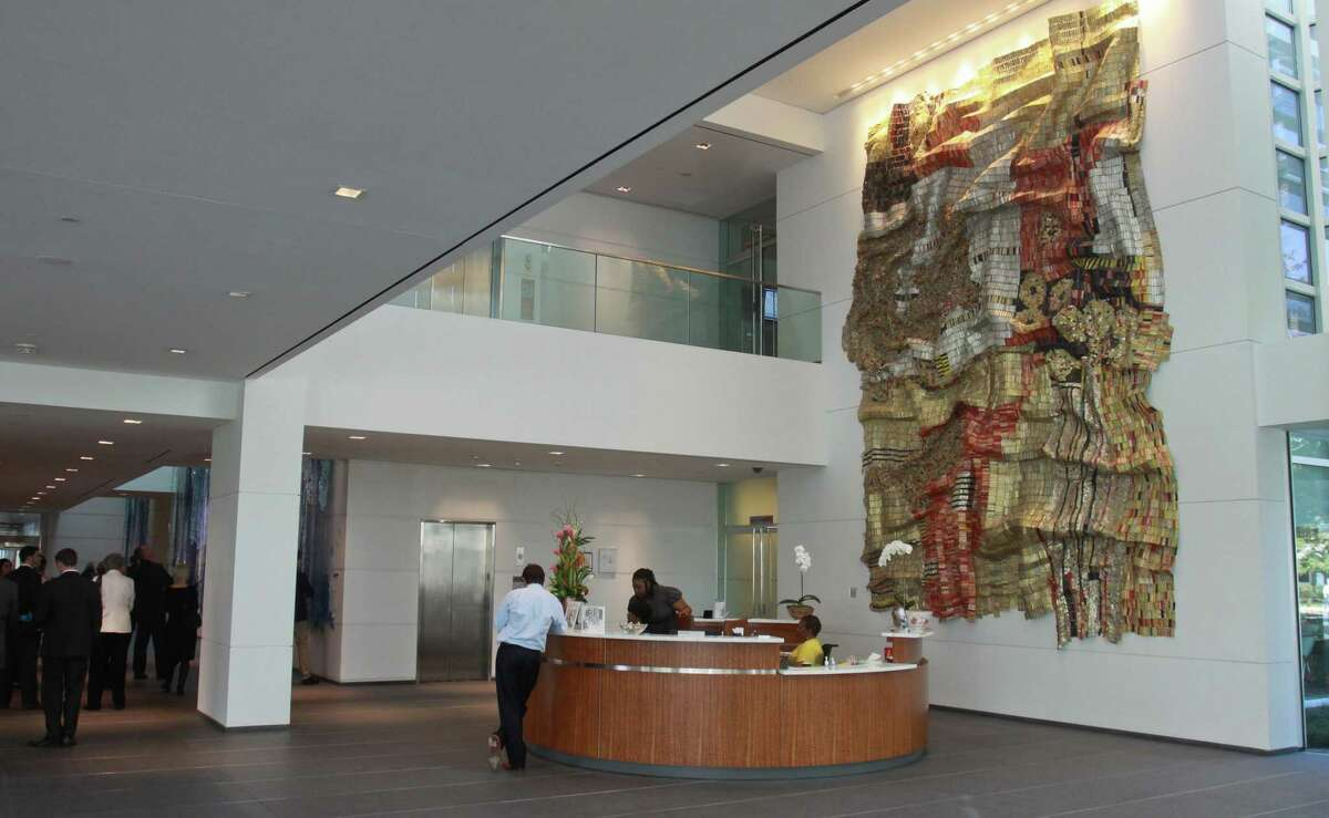 """(For the Chronicle/Gary Fountain, March 5, 2013) Art """"Wrinkle of the Earth 2,"""" by El Anatsui in the reception area of ConocoPhillips."""