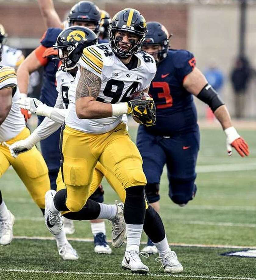 Iowa's A.J. Epenesa (94), a junior from Edwardsville, has been named a preseason first-team All-America by the Associated Press and has been named to the Ted Hendricks Award Preseason Watch List. Above, he returns a fumble for a touchdown against Illinois last season. Photo: AP File Photo