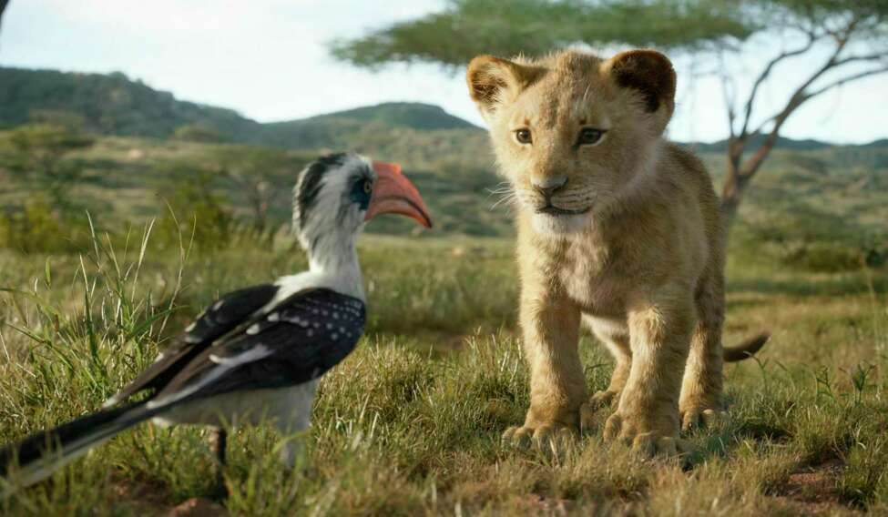 This image released by Disney shows characters, from left, Zazu, voiced by John Oliver, and young Simba, voiced by JD McCrary, in a scene from