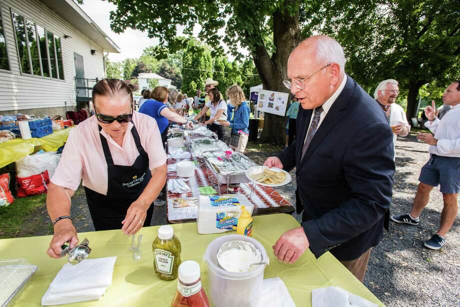 Maria Sawkiw helps U.S. Congressman Paul Tonko fill his plate as the Ukrainian Congress Commitee held the third annual Ukrainian Festival in Cohoes, NY Saturday, August 25th, 2018. The event expected to draw approximately 500 people to learn, experience and enjoy Ukrainian culture and cuisine. Photo by Eric Jenks, for the Times Union Photo: Eric Jenks / Eric Jenks 2018