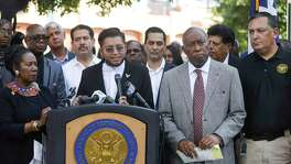 Cesar Espinosa, with FIEL, speaks along with Congresswoman Sheila Jackson Lee, Houston mayor Sylvester Turner and Houston police chief Art Acevedo during a gathering to honor the victims of the recent mass shootings in El Paso, TX and Dayton, OH, in downtown Houston, Sunday, Aug. 4, 2019.