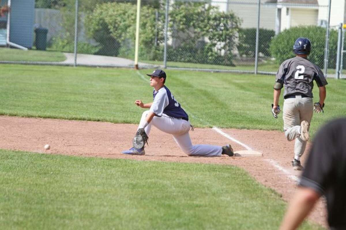 Manistee first baseman Austin Harper stretches for a throw in Game 2 of Sunday's doubleheader against the Oil City Stags at Rietz Park. Manistee was swept in the four-game series, falling by scores of 9-3 and 0-5 on Saturday and 10-5 and 8-2 on Sunday. (Kyle Kotecki/News Advocate)