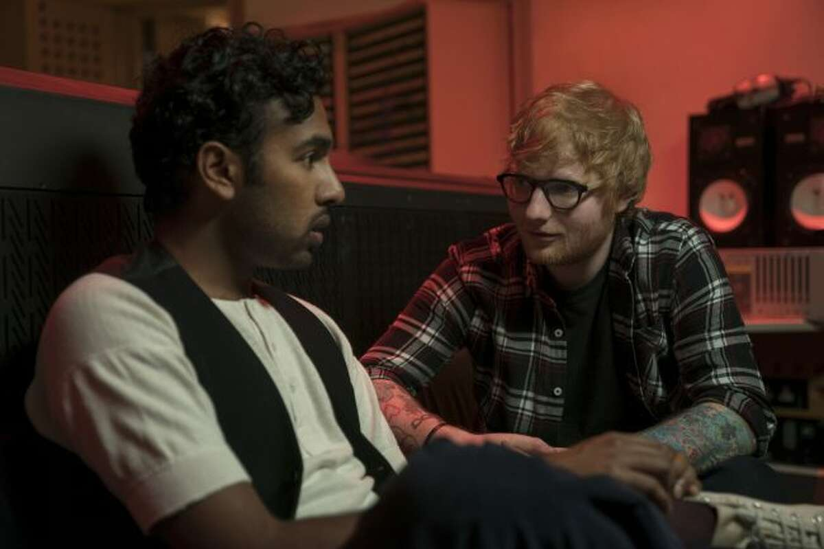 """This image released by Universal Pictures shows Himesh Patel, left, and Ed Sheeran in a scene from """"Yesterday."""" (Jonathan Prime/Universal Pictures via AP)"""
