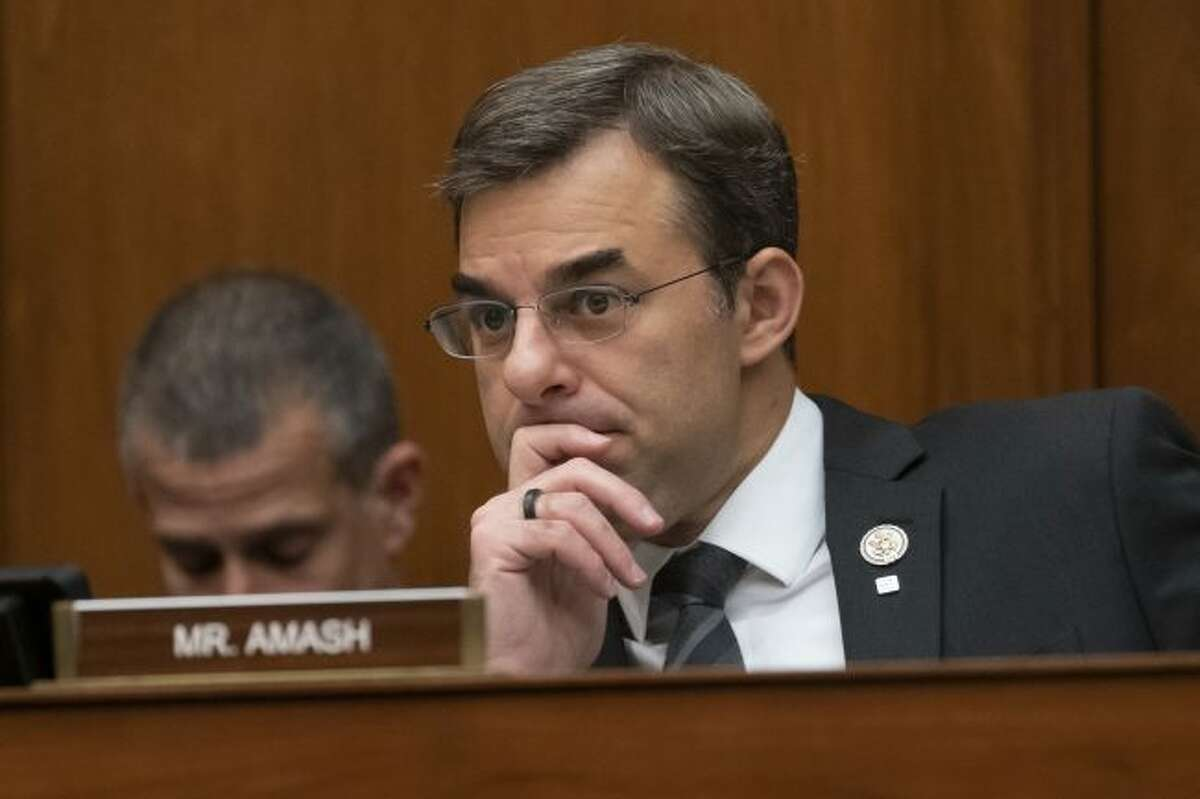 """In this June 12, 2019 file photo, Rep. Justin Amash, R-Mich., listens to debate as the House Oversight and Reform Committee considers whether to hold Attorney General William Barr and Commerce Secretary Wilbur Ross in contempt for failing to turn over subpoenaed documents related to the Trump administration's decision to add a citizenship question to the 2020 census, on Capitol Hill in Washington. Amash, the only Republican in Congress to support the impeachment of President Donald Trump, said Thursday, July 3 he is leaving the GOP because he has become disenchanted with partisan politics and """"frightened by what I see from it."""" (AP Photo/J. Scott Applewhite, File )"""