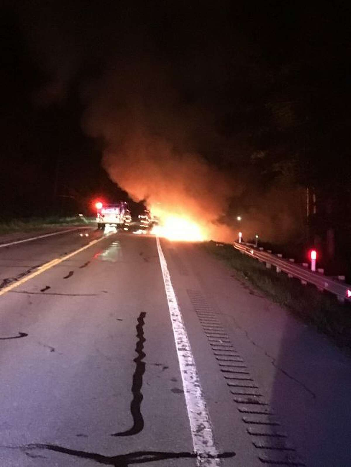 Michigan State Police troopers responded to a car/deer crash around 11:40 p.m. on Thursday on M-115 and Viaduct Road in Cleon Township that turned into a car fire. The car was occupied by a family on vacation from Ohio. Everyone got out without injuries and they were able to save most of their belongings, according to MSP. (Courtesy photo)