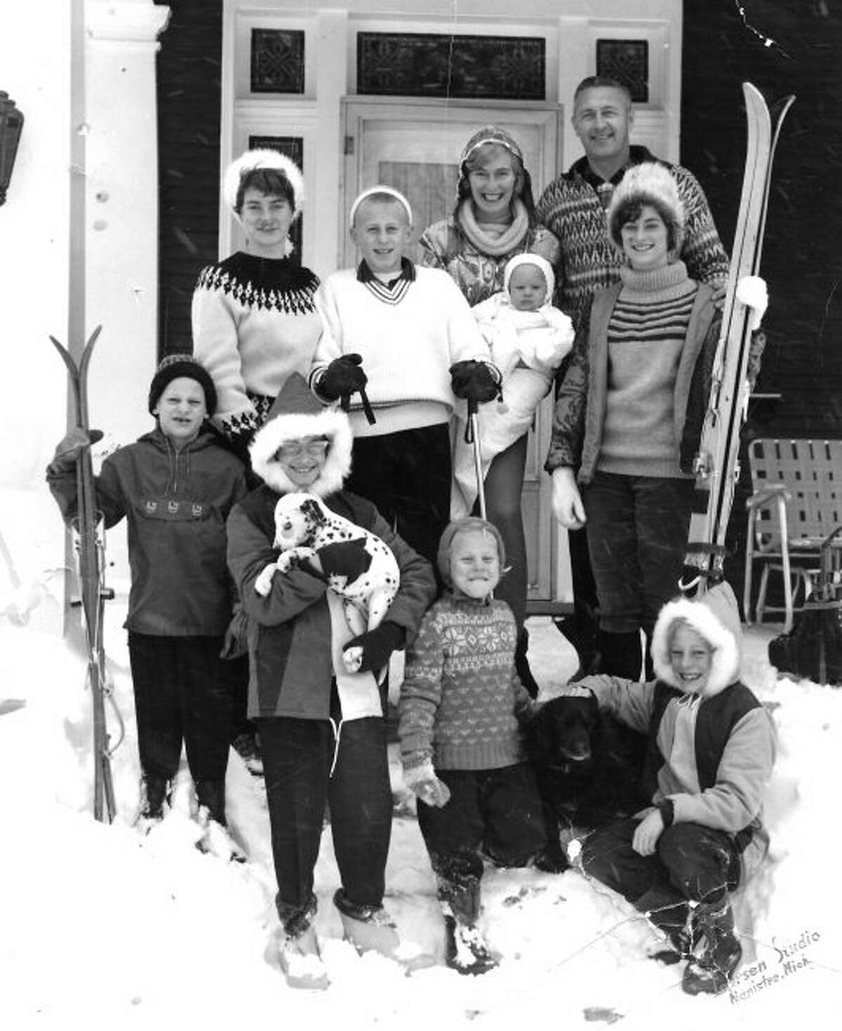 Members of the Bultema family pose for a photograph outside their home located at 427 Fifth Street. This week, members of the family have converged in Manistee to participate in a reunion.