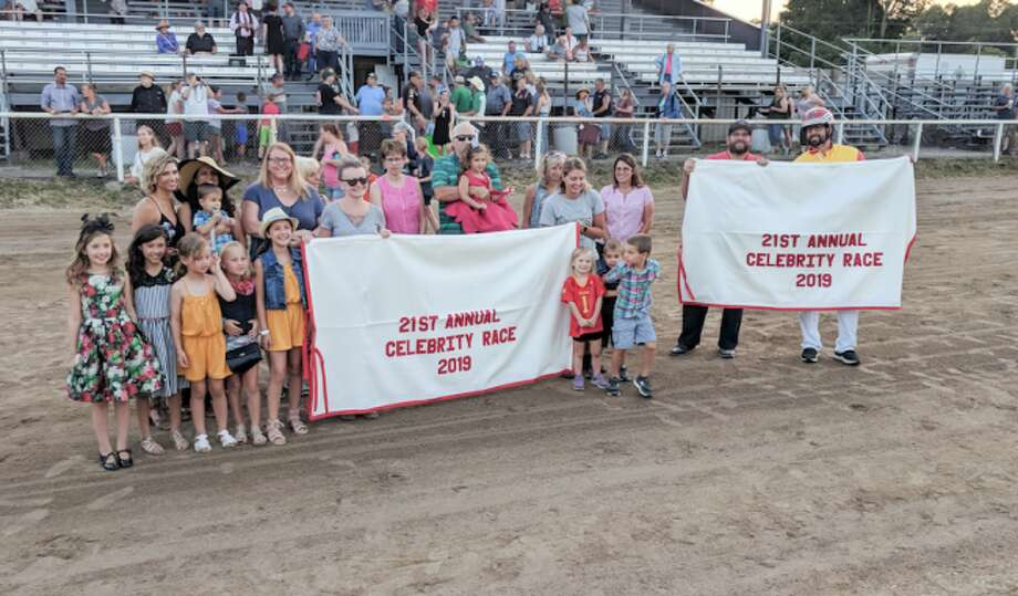 Andy Bronkema (far right) poses for a photo with friends and family after winning the 2019 Celebrity Harness race. (Pioneer photo/Maxwell Harden)