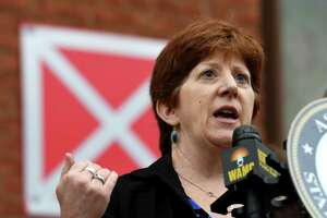 Albany Mayor Kathy Sheehan speaks during a press conference to tout a new bill aimed at shortening the foreclosure redemption period for vacant and abandoned buildings on Wednesday, Aug. 21, 2019, in Albany, N.Y. The bill, sponsored by Assemblyman John T. McDonald III and Sen. James Gaughran, has passed both houses of the New York State Legislature. (Will Waldron/Times Union)