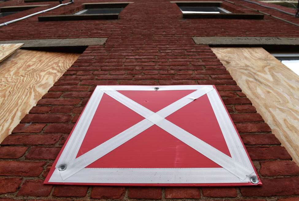 A Delaware Street building is marked with a red and white X placard that indicates it is unsafe on Wednesday, Aug. 21, 2019, in Albany, N.Y. A bill sponsored by Assemblymember John T. McDonald III and Sen. James Gaughran would shorten the foreclosure redemption period for vacant and abandoned buildings. The bill has passed both houses of the New York State Legislature. (Will Waldron/Times Union)