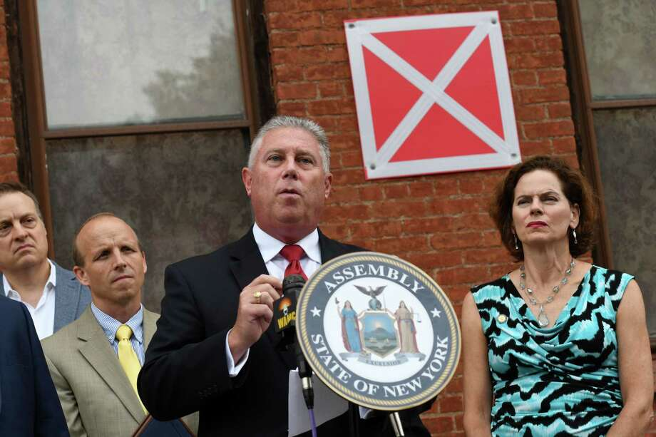 Assemblyman John T. McDonald III, center, is joined by Assemblymember Patricia Fahy, right, as he speaks during a press conference to tout a new bill aimed at shortening the foreclosure redemption period for vacant and abandoned buildings on Wednesday, Aug. 21, 2019, in Albany, N.Y. The bill, sponsored by McDonald and Sen. James Gaughran, has passed both houses of the New York State Legislature. (Will Waldron/Times Union) Photo: Will Waldron, Albany Times Union / 40047697A