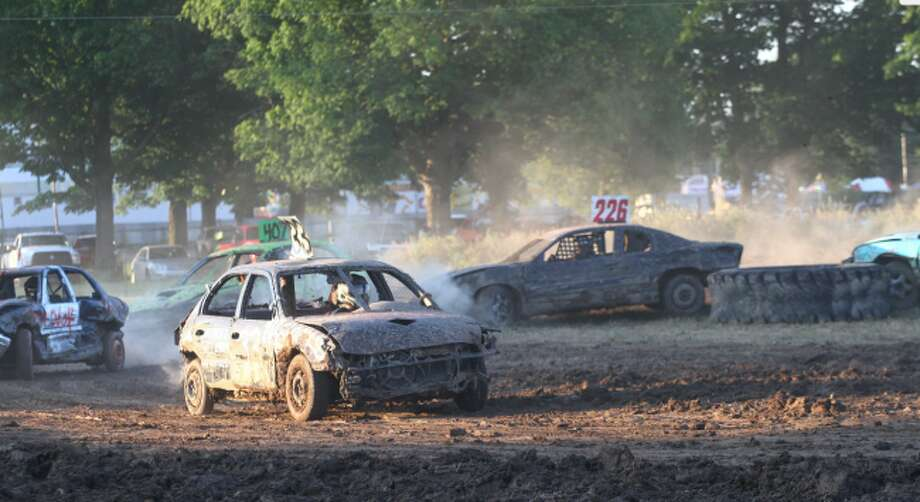 "Big Rapids native Justin Burrows flies down the mud track in his ""33"" car during Wednesday's Off Road Derby presented by Unique Motor Sports. (Pioneer photo/Maxwell Harden)"