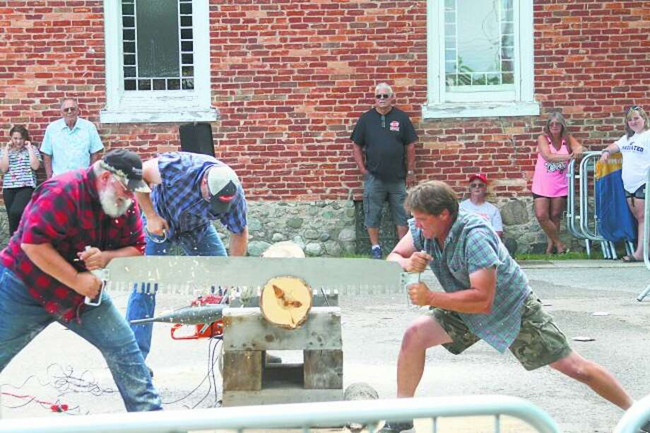 The three performances of the Lumberjack show drew lots of people who enjoyed both their skills and antics. (Ken Grabowski/News Advocate)