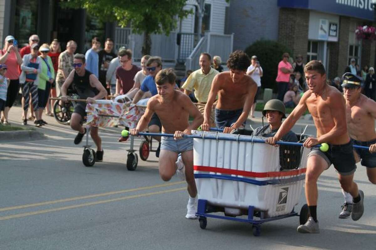The Post Office team (right) - consisting of Manistee High School graduates Issac, Elmo, Rocco in bed, Bryson and Logan - won first place in the Bed Races on Sunday. (Dylan Savela/News Advocate)