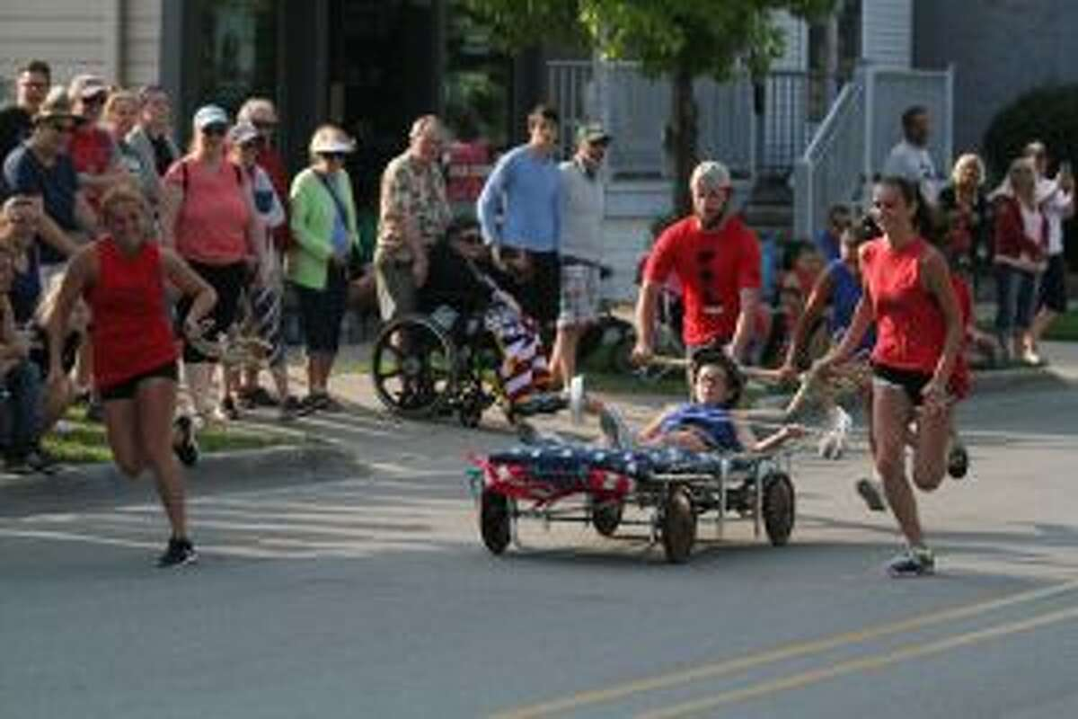 Teams competed to win money for the charity of their choice during the Bed Races as part of the Manistee National Forest Festival. (Dylan Savela/News Advocate)
