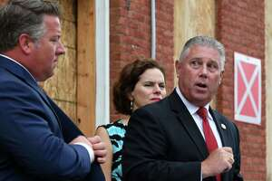 Assemblyman John T. McDonald III, center, is joined by Albany County Executive Dan McCoy, left, and Assemblymember Patricia Fahy, right, as he speaks during a press conference to tout a new bill aimed at shortening the foreclosure redemption period for vacant and abandoned buildings on Wednesday, Aug. 21, 2019, in Albany, N.Y. The bill, sponsored by McDonald and Sen. James Gaughran, has passed both houses of the New York State Legislature. (Will Waldron/Times Union)