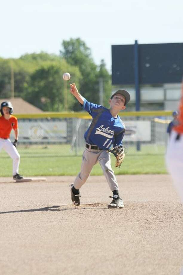 Bennett Zeller, of the Lake Michigan Lakers' 9-U team, delivers a pitch at a recent home tournament. The Lake Michigan Lakers program provides a platform for local youth to hone their skills on the diamond. (Dylan Savela/News Advocate)