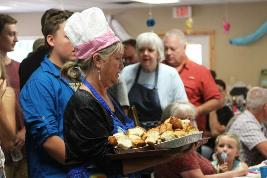 Volunteers and board members of Little Mary's Hospitality House serve food to attendees of the gala on Saturday. (Ashlyn Korienek/News Advocate)