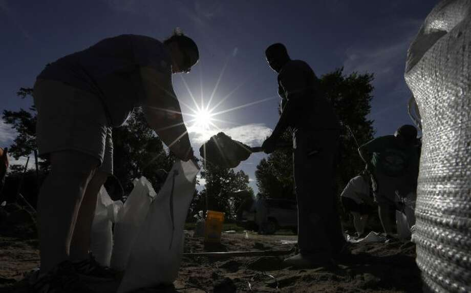 Residents fill sandbags Friday, July 12, 2019, in Baton Rouge, La., ahead of Tropical Storm Barry. The National Weather Service in New Orleans says water is already starting to cover some low lying roads in coastal Louisiana as Barry approaches the state from the Gulf of Mexico. (AP Photo/David J. Phillip)