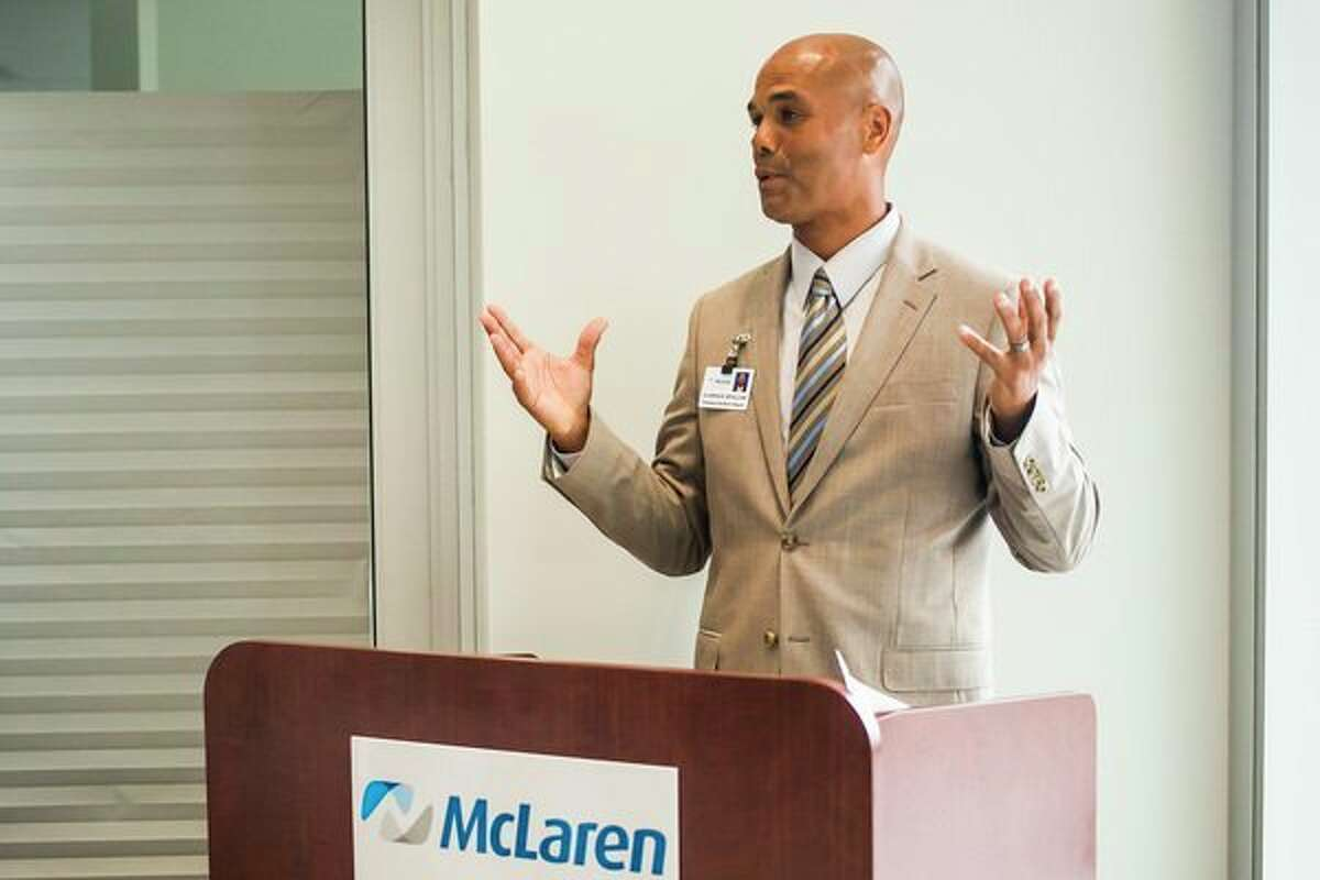 Clarence Sevillian, president/CEO of McLaren Bay Region, speaks during a ribbon cutting and open house event Tuesday for a new facility at 801 Joe Mann Blvd. in Midland. (Katy Kildee/kkildee@mdn.net)