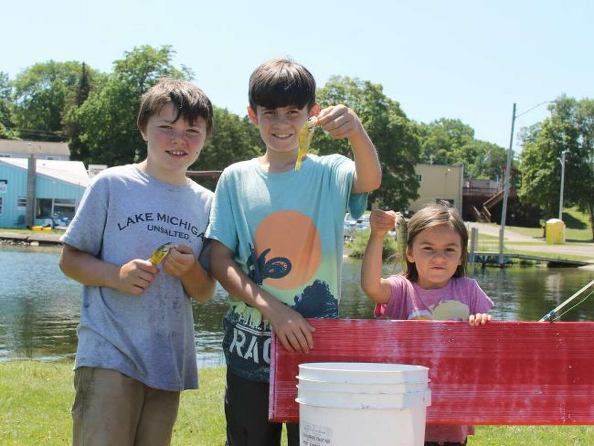 Young anglers show off the yellow perch they caught for the Kid's Fishing Contest. (Scott Fraley/News Advocate)
