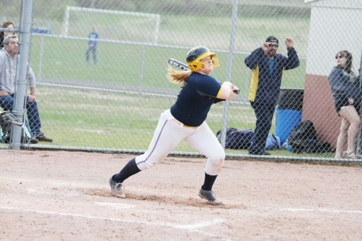 Manistee's Erin Vander Weele puts the ball in play.Vander Weele, Ashley Walle and Emma Witkowski were named to the All-Lakes 8 Conference list for their performances this spring. (News Advocate file photo)