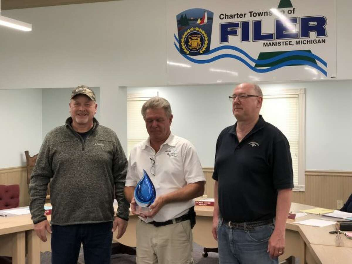 Pictured: Mike Hiller (left), Filer Township water operator, and Tom Stege (right), Filer Township treasurer, receiving the award from Brian Minor, of the Michigan Rural Water Association. (Courtesy Photo/Terry Walker)