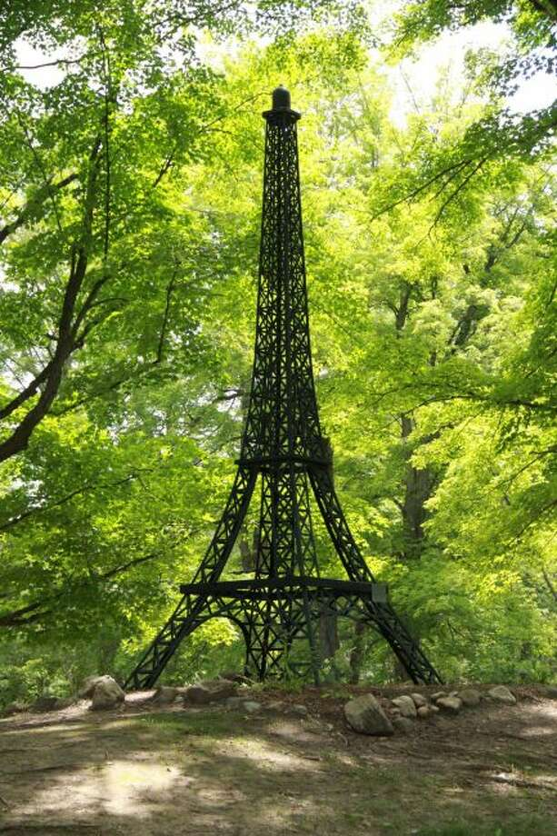 Campers can take memorable photos with this Eiffel Tower replica. This tower can be found on a trail in Paris Park. (Pioneer photo/Alicia Jaimes)