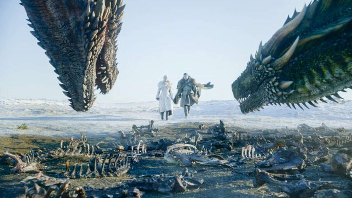 """This image released by HBO shows Emilia Clarke, left, and Kit Harington in a scene from """"Game of Thrones,"""" premiering on Sunday, April 14. The first episode of the final season of """"Game of Thrones"""" is a record-breaker for the series and HBO. The pay channel said the 17.4 million viewers who watched Sunday's episode either on TV or online represent a season-opening high for the fantasy saga. (HBO via AP)"""