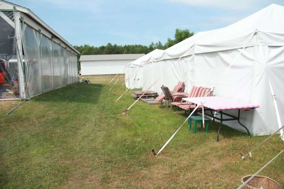Tents are being set up in preparation of this year's annual yard sale. Each of these tents house different types of products including kitchenware, fishing, exercise equipment and clothes (Pioneer photo/Alicia Jaimes)