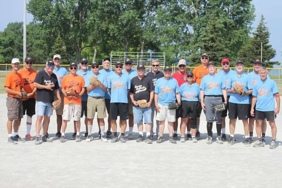 "Manistee's senior softball group, pictured in the front row (left to right): James ""Texas"" Picardat, Ray ""Reverend"" Latham, Ron ""Slick"" Helmboldt, Dave ""Van Gogh"" Crockett, Mike ""Brooks"" Kaufman, Stu ""Jarhead"" Swiger, Bill ""Scoop"" Connor, Lisa ""Whitemouse"" Fragomeli, Ed ""Jonesy"" Jones, Chuck ""Crooner"" Dillon and Russ ""Popeye"" Wrzesinski. Back row (left to right): Bill ""Hammer"" Mason, Roger ""Smokey"" Elbers, Garry ""Moonlight"" Cole, Dale ""Merk"" Merkey, John ""Space"" Kudalski, Bernie ""Boomer"" Misko, Mike ""Trammel"" Phelps, James ""Preacher"" Schmeling, Phil ""Crusher"" Kench, Dan ""Buster"" Birchmeier. (Kyle Kotecki/News Advocate)"