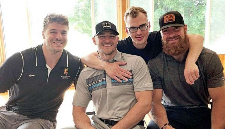 NFL players pose with Evan Williams at last week's Area 5 Special Olympics golf outing at the Clear Lake Golf Club. From left are Brady Sheldon, Jake Lampman, Williams and Justin Currie. Williams competes in Special Olympics. (Courtesy photo)