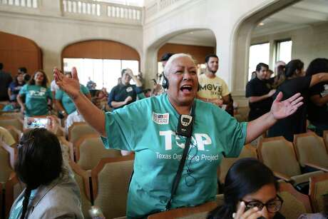Merced Leyva reacts after the San Antonio City Council approves a paid sick leave ordinance Aug. 16, 2018. The ordinance was scheduled to take effect Aug. 1, but a judge approved a city government-business community deal to delay that until Dec. 1 to give the city's Paid Sick Leave Ordinance time to suggest changes to make the ordinance more palatable to the business community. Wednesday, the commission began discussing a new draft of a revised ordinance.