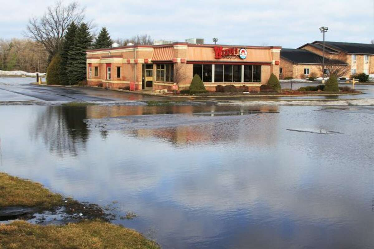 Following a huge winter storm and warm up event in March, Manistee County saw some flooding in parking lots, roadways and even in residential areas. (Ken Grabowski/News Advocate)