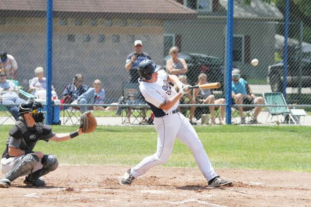 The Manistee Saints' Travis McCormick knocks an RBI single Sunday at Rietz Park during his team's sweep of the Mid Michigan Starz. (Dylan Savela/News Advocate)