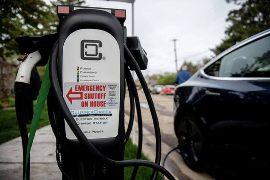 A newly-installed curbside electric vehicle charging station in the Pittsfield Village neighborhood, Tuesday, May 7, 2019 in Ann Arbor.