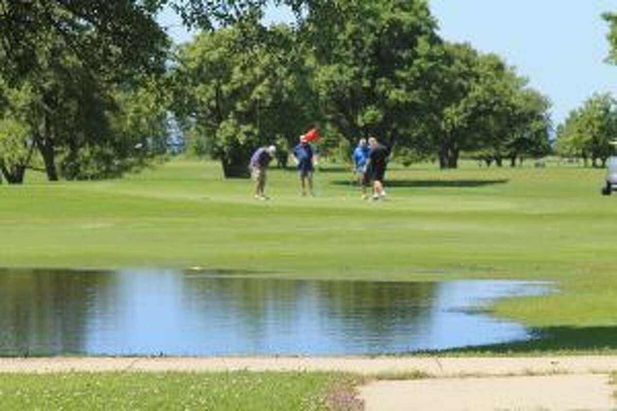 Standing water presents a new hazard for golfers at the Manistee Golf and Country Club. (Scott Fraley/News Advocate)