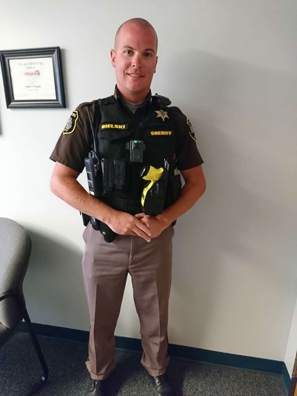 Deputy sheriff Jake Bielski wears his new load-bearing vest that is full equipped with gear. The new vests replace the old bulletproof vest and duty belt combination. (Ashlyn Korienek/News Advocate)