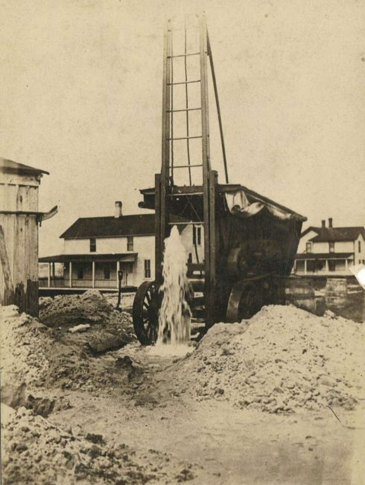 An artesian well in Onekama is shown bubbling up to the surface in the early 1900s.
