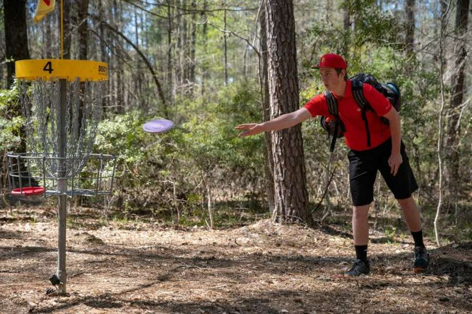 Patrick Nemmer throws his disc in hopes of making his target. Disc golf gives players the chance to play in a more natural setting compared to regular ball golf, according to Big Rapids Disc Golf Club President Foster Neil. (Courtesy photo/Josh Black)