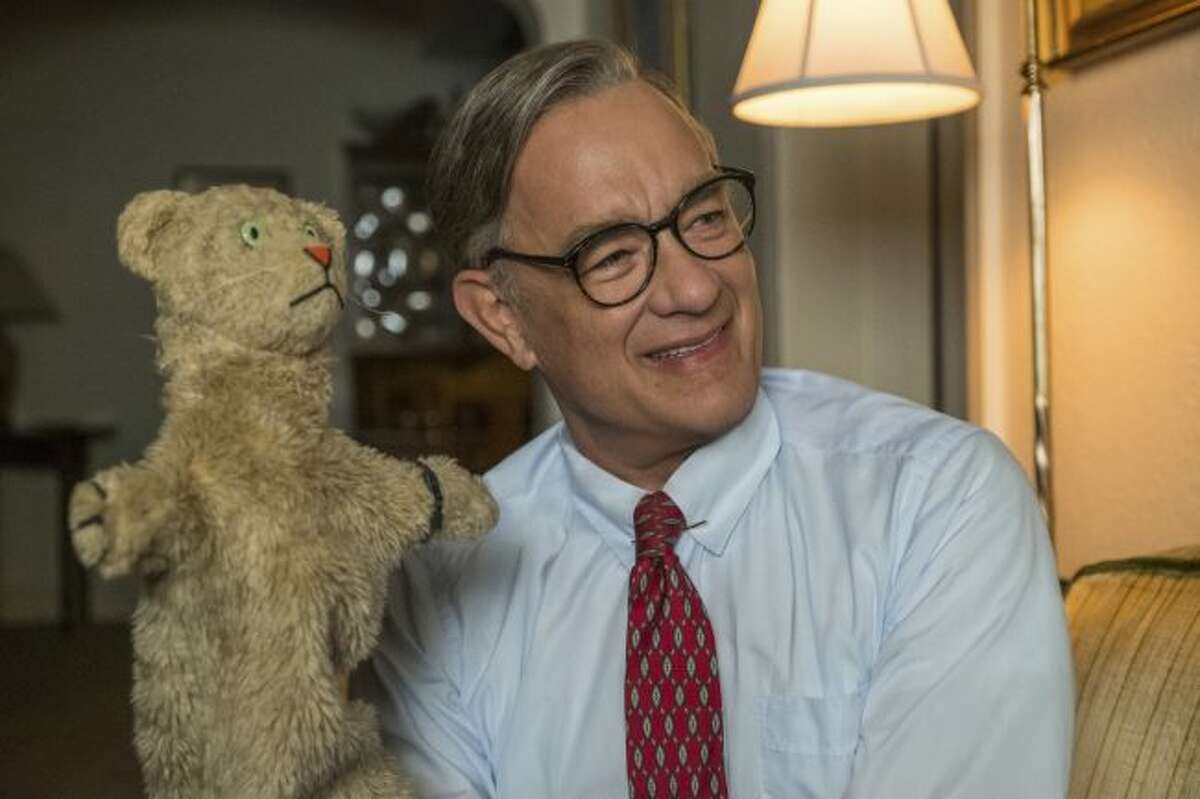 """This image released by Sony Pictures shows Tom Hanks as Mister Rogers in a scene from """"A Beautiful Day In the Neighborhood. The Mr. Rogers biopic will premiere at the Toronto International Film Festival in September. (Lacey Terrell/Sony-Tristar Pictures via AP)"""