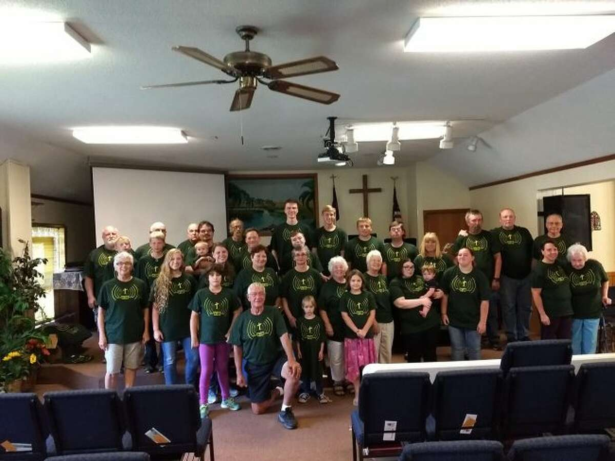 Congregants from the Kaleva Bible Church pose in Beyond KBC Walls T-shirts. (Courtesy Photo)