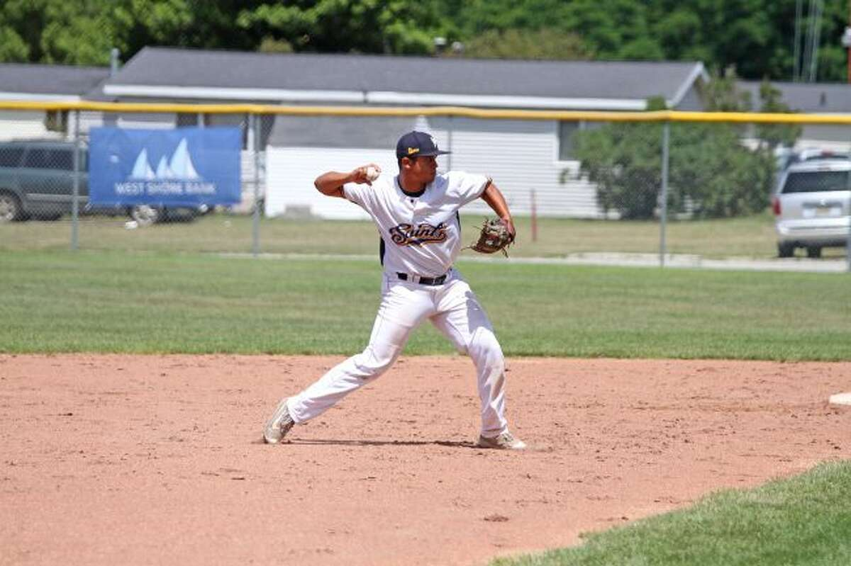Saints' shortstop Trenton Smiley fires to first during last Sunday's doubleheader. Manistee hosts the Midland Tribe for a four-game series this weekend, and will hold an 85th Birthday Bash Saturday and a Hall of Fame induction on Sunday. (News Advocate file photo)