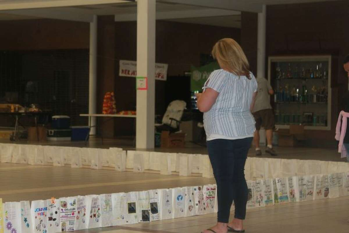 Luminaries mark the names of those lost to cancer, survivors, and those currently afflicted. Their impact can be overwhelming at Relay for Life events like the one held Saturday at the Manistee High School.(Scott Fraley/News Advocate)
