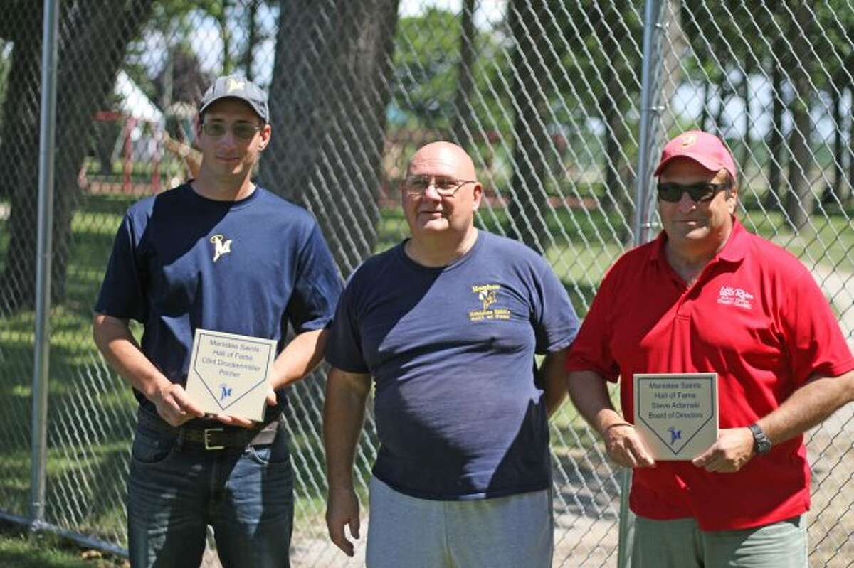 The newest members of the Manistee Saints Hall of Fame hold the plaques that will become a permanent part of Rietz Park at the Saints' induction ceremony on Sunday. From left, Clint Druckenmiller, club president Mike Gielczyk and Steve Adamski. (Kyle Kotecki/News Advocate)