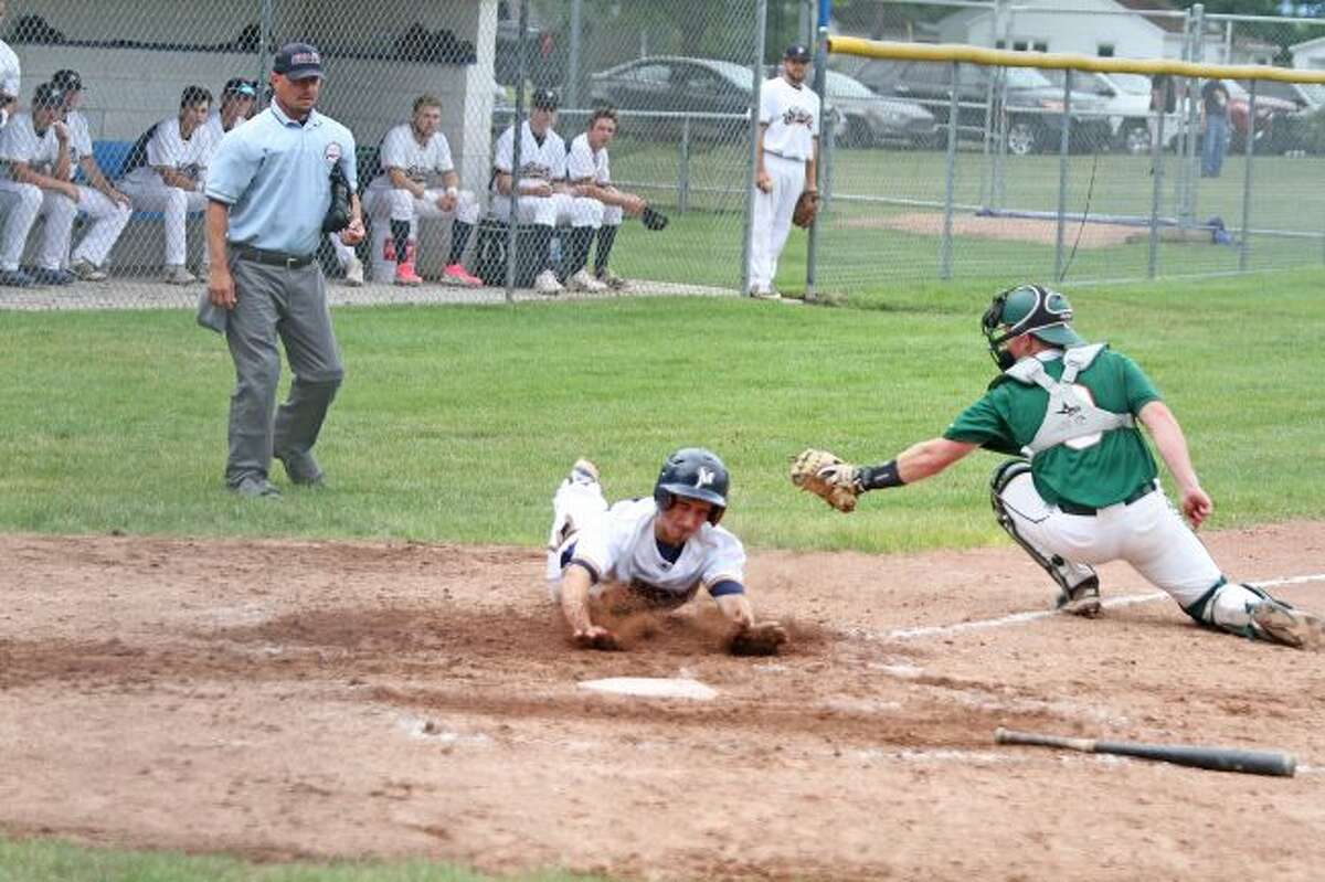 Manistee's Lucas Weinert slides into home during Saturday's 11-4 loss to the Midland Tribe. (Kyle Kotecki/News Advocate)