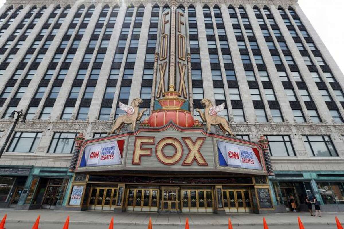 The marquee at the Fox Theatre displays signs for the Democratic presidential debates in Detroit, Monday, July 29, 2019. The second scheduled debates, hosted by CNN, will be held Tuesday, July 30 and Wednesday, July 31. (AP Photo/Paul Sancya)