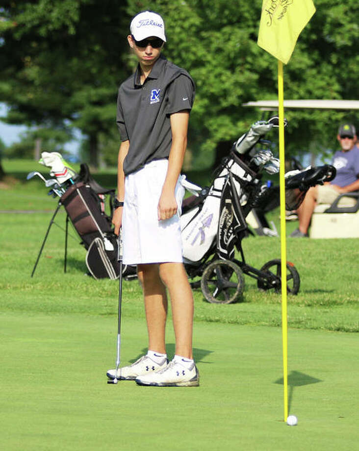 Marquette Catholic junior William Roderfeld watches his birdie putt barely miss the cup on hole No. 1 at Belk Park on Monday at the Hickory Stick Invitational boys golf tournament in Wood River. Roderfeld tied for second place with a 77. Photo: Greg Shashack / The Telegraph