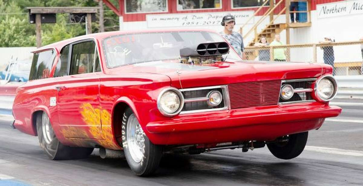Mopar racer Dan Bryeans, of Algonac, launches his '64 Cuda Wagon in Bracket II competition. Bryeans picked up many wins over the weekend, making it down to the final 22 entries in the $10,000 to win race. (Photo courtesy of Lane Automotive)